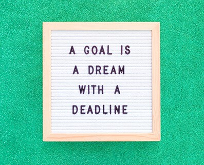 Sign that states: A Goal is a dream with a deadline